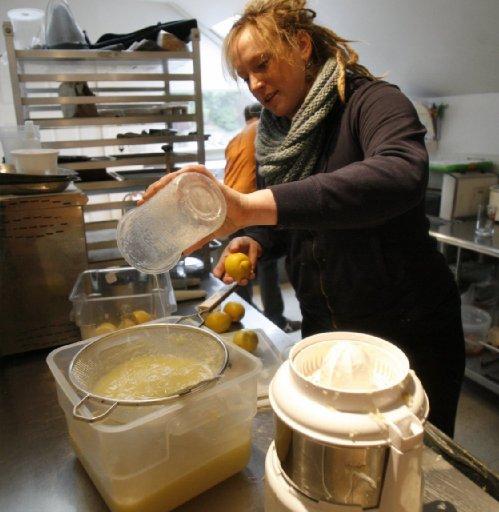 Rachel Marshall straining lemon juice at Licorous for Rachel's Ginger Beer [Sea Times Courtney Blethen Riffkin]