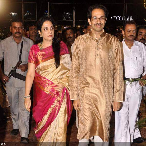 Uddhav Thackeray with wife Rashmi arrive at Ramesh and Seema Deo's 50th wedding anniversary, held at ISKCON, in Mumbai, on July 1, 2013. (Pic: Viral Bhayani)