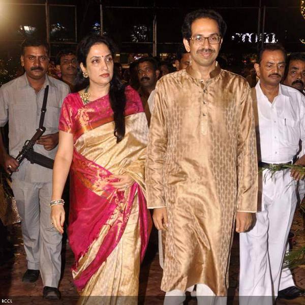 Uddhav Thackeray with wife Rashmi arrive at Ramesh and Seema Deo's 50th wedding anniversary, held at ISKCON, in Mumbai, on July 1, 2013. (Pic: Viral Bhayani)