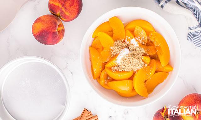 peach crisp recipe - peaches and spices in a bowl