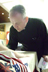 Fr. Frain signs Evie Imperato's Freedom Quilt