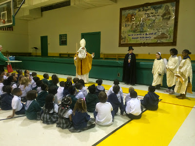 St. Nicholas Visits St. Angela Merici Students