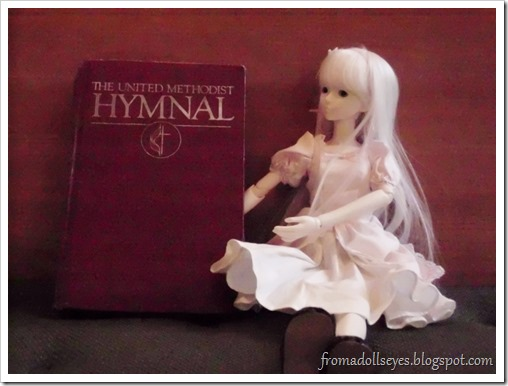 Ball jointed doll with a Hymnal