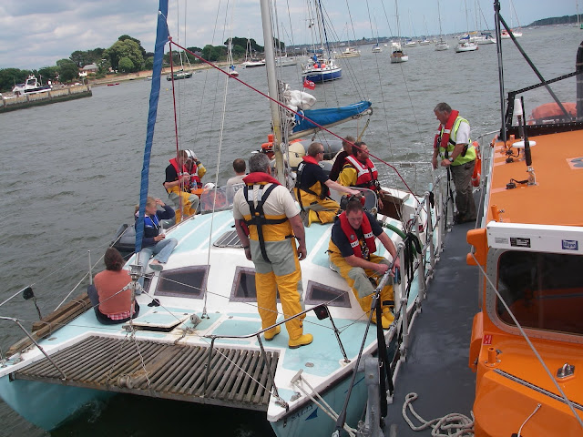 Crew members discussing towing a vessel alongside