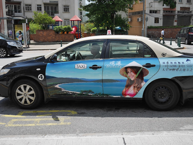 Macau taxi with advertisement for Danang, Vietnam