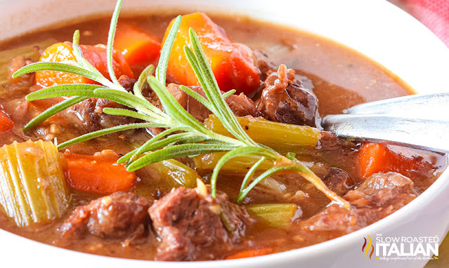 Instant Pot Beef Stew in a white bowl with chunks of meat and vegetables