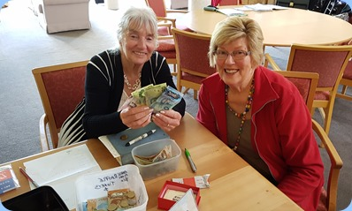 Delyse Whorwood and Kay Boyes sorting the raffle money at our entry desk.