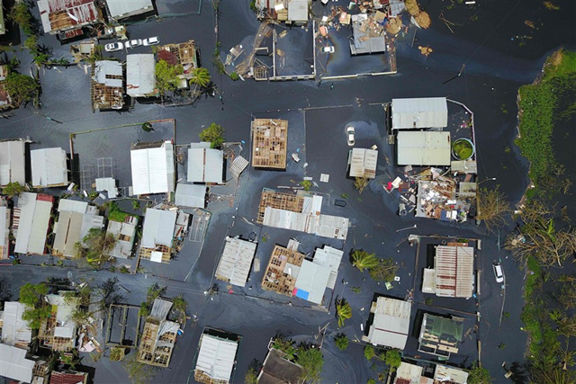 An aerial view shows the flooded neighborhood of Juana Matos in the aftermath of Hurricane Maria in Catano, Puerto Rico, on 22 September 2017. Photo: Ricardo Arduengo / AFP / Getty Images
