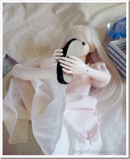 Ball Jointed Doll Trying to Get Her Shoes On