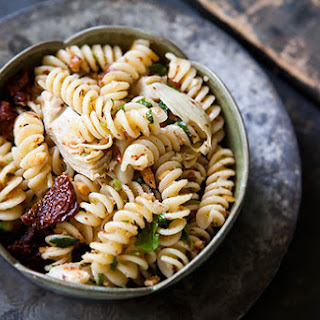 Pasta with Artichoke Hearts, Sun Dried Tomatoes, and Toasted Almonds.