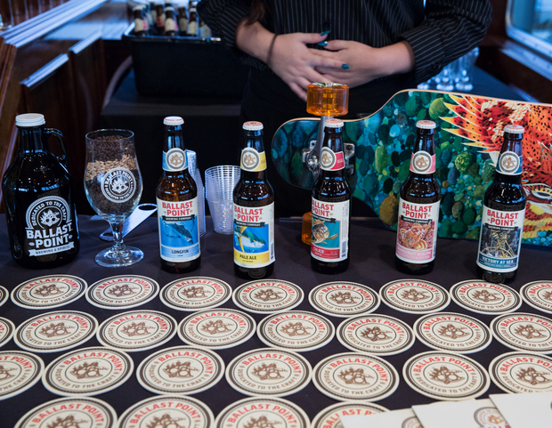 photo of different bottles of ballast point beer bottles and coasters