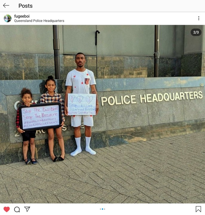 EndSARS: Nigerian Man Protests In Australia With His Daughters (Photos)
