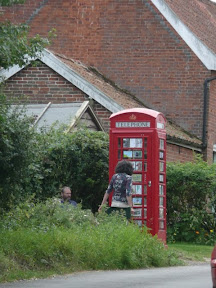glemham phone box - this was being used as an art gallary for postcard sized water colours - excellent!