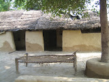 The poorest villagers still live in houses made of mud, straw and dung and sleep on handmade rope beds.