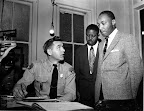 King Booked - Montgomery 1956 Rev. Martin Luther King, Jr. (right), accompanied by Rev. Ralph D. Abernathy (center), is booked by police lieutenant D. H. Lackey in Montgomery on February 23, 1956. (AP/Wide World Photos)