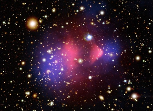 The-Bullet-cluster-1E-0657-558-consists-of-two-colliding-galaxy-clusters-in-Carina_-Most-of-the-matter-in-the-clusters-blue-is-separate-from-the-normal-matter-pink-giving-evidence-th
