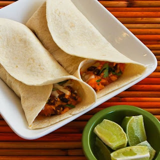 Slow Cooker Vegetarian Sweet Potato and Black Bean Burritos with Lime.