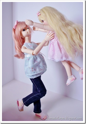 A bjd picking up another bjd.