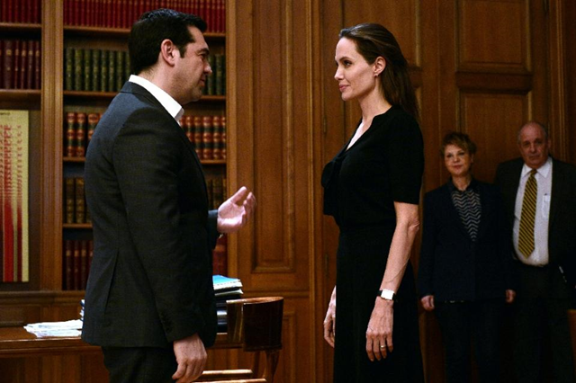 Greek Prime Minister Alexis Tsipras (L) welcomes the UNHCR's Goodwill Ambassador Angelina Jolie at his office in Athens on 16 March 2016 Photo: Louisa Gouliamaki / AFP Photo