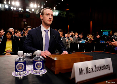 Facebook CEO Mark Zuckerberg arrives to testify before a Senate Judiciary and Commerce Committees joint hearing regarding the company's use and protection of user data, on Capitol Hill in Washington, U.S., April 10, 2018. REUTERS/Aaron P. Bernstein - HP1EE4A1G5B54
