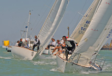 J/24 one-design sailboats- starting off Buenos Aires, Argentina