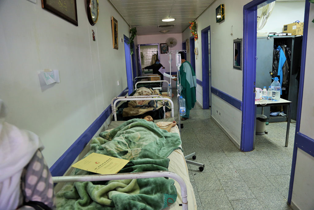 Beds are lined up in a hallway due to overcrowding in the paediatric ward at Al-Thawra Hospital, Sana'a, Yemen. Photo: Rajat Madhok / UNICEF
