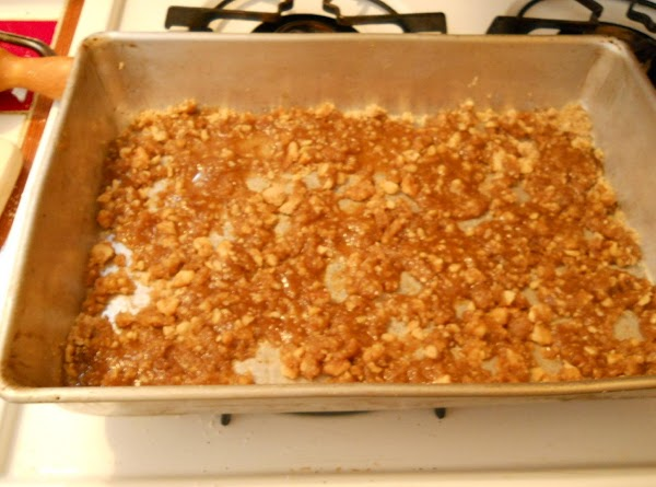 Mix brown sugar, nuts, and syrup in ungreased 13x9x2 inch pan. Spread evenly.