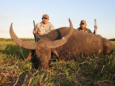 Mr John Gustainis, USA with a beautiful buffalo bull, 102SCI