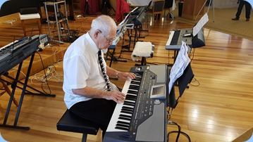 Fairview Village resident, George Markwick, playing his Korg Pa800.