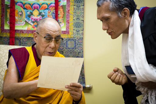 His Holiness the Dalai Lama reading a letter from Lama Zopa Rinpoche with Yangsi Rinpoche, FPMT International Office, Portland, Oregon, U.S., May 10, 2013. Photo by Leah Nash.