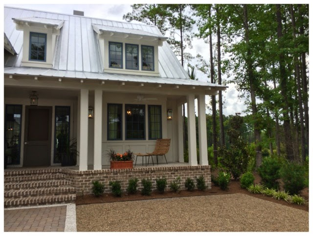 Cute front porch and screened door.  2014 Southern Living Idea House in Palmetto Bluff, SC | The Lowcountry Lady