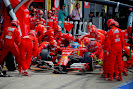 Fernando Alonso does a pit stop for Ferrari