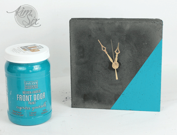 Teal and concrete clock