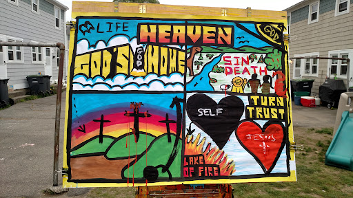 This is what the painting looked like after I taught the Bible lesson. God's home is Heaven. He decides who gets in and out. God made everything perfect, but sin and death came when we broke His law. We were separated from God and we're now God's enemy. Jesus came down, lived a perfect life, never sinned, and died on the cross. He rose from the dead! Two others were crucified with Him. One made fun of Jesus, showing that his heart was focused on himself. This is how we all start out, and it leads us to the Lake of Fire. The other criminal believed in Jesus and looked to Him as his only Savior. He will forever be with the Lord in Heaven. And so will we if, like the second criminal, we turn from our sin (repent) and trust in the gospel (believe.) Good Theology there!