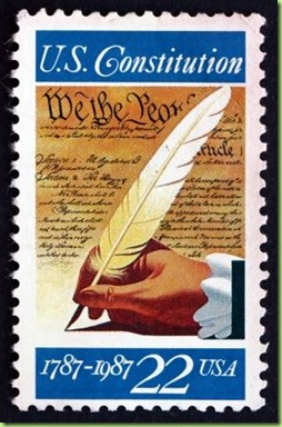 22319375-united-states-of-america-circa-1987-a-stamp-printed-in-the-usa-shows-hand-with-quill-pen-signing-of-
