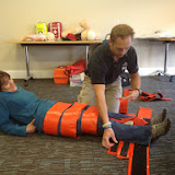 Casualty Care Trainer Grant Walkey demonstrating how to immobilise a casualty using six fracture straps - July 2014 Photo: Dave Riley