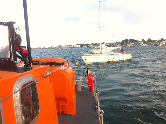 21 August 2012 - the ALB approaches the yacht to transfer a crew member aboard. Photo: RNLI Poole/Dave Riley