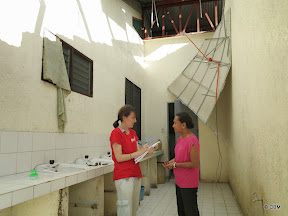 Two women assessing damage in a bathroom