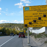 the sign as you leave Baie Comea, heading north. When a light is flashing, that section of the road is closed.
