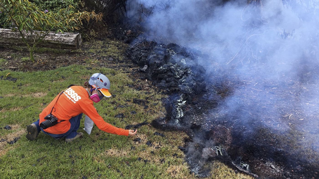 A U.S. Geological Survey geologist collects samples of lava spatter for laboratory analysis on Hawaii on 6 May 2018. Photo: U.S. Geological Survey / Associated Press