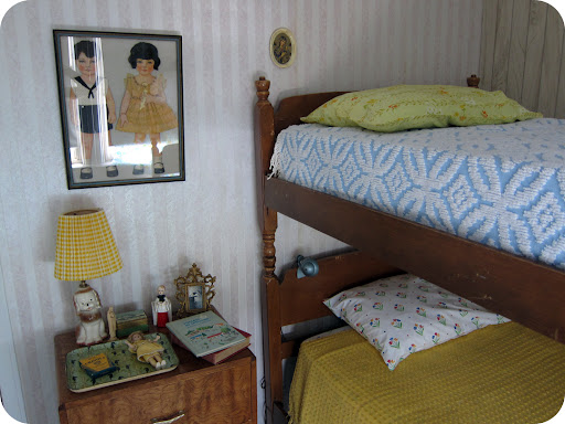 Bedroom. The paper doll art on the wall is a antique handmade piece I found on Ebay. They have real human hair! http://lemmemakeit.blogspot.com/2011/04/paper-dolls.html