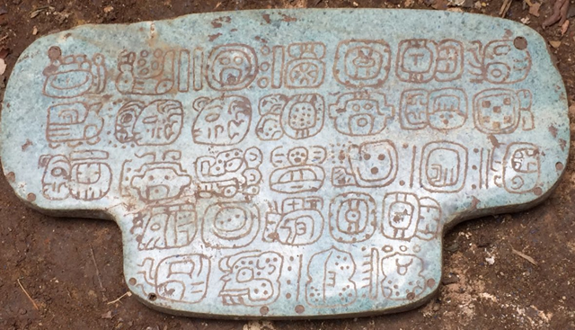This jade once belonged to an ancient Maya king and is inscribed with 30 hieroglyphs. It was used during important religious ceremonies. Photo: G. Braswell / UC San Diego