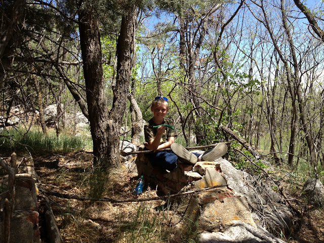 Michael (Great-great grandson of the owners of the JL Ranch) sitting on the foundation of an old underground fuel storage tank near the old homestead.