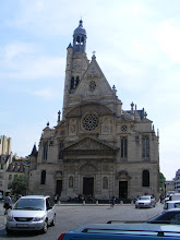 Photo: We are now firmly in the Left Bank university area, here facing the Gothic exterior of the Church of St-Etienne-du-Mont, built over a long period between 1492 and 1626. The Church occupies the site of an abbey founded by Clovis and later dedicated to St. Genevieve, the patroness of Paris. St. Genevieve's tomb was destroyed during the Revolution, but the stone on which her coffin rested was discovered later, and her relics were gathered for a place of honor at St-Etienne.