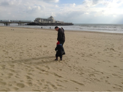 My boys walking along the beach at Bournemouth