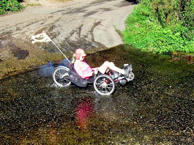Three wheel recumbent riding through ford
