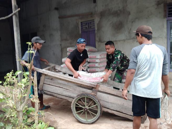 Gotong Royong Warga dan Tim Satgas TMMD