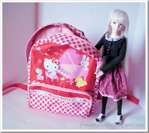 Inside the cute Hello Kitty backpack is a small thrift store haul of possible doll props.