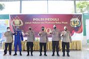 Hadiri Pelaksanaan Vaksinasi Covid-19 Di Pesantren Ummul Mukminin Aisyah,Kapolda Sulsel Serahkan 500 Paket Bansos