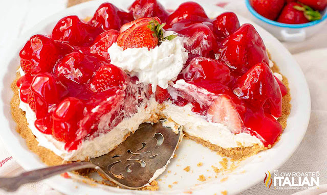 No-Bake Strawberry Cheesecake on a cake plate